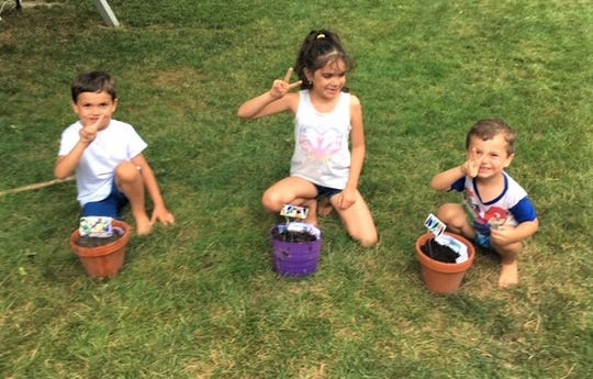 The experimenting children are Kelton Dotson, Matthew Dotson, and Olivia Dotson.