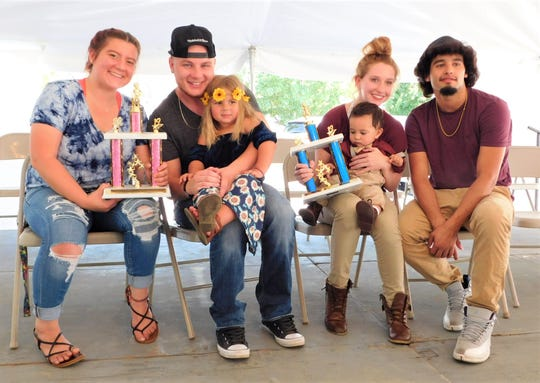 Winners of the 2019 Clyde Beautiful Baby Contest, Top Girl and Top Boy and their parents, are, from left, Ciara Kizziah and Levi Chaffee of Clyde holding winner Nova-Rae Chaffee, then Autumn Byers holding winner Liam Vargas and Jesse Vargas of Fremont.