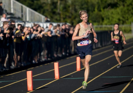 Ethan Tank of Southwest Florida Christian Academy crosses the finish line in first place followed by Cooper Banks of Bishop Verot in second place on Tuesday, Sept. 24, 2019, at Bishop Verot High School.