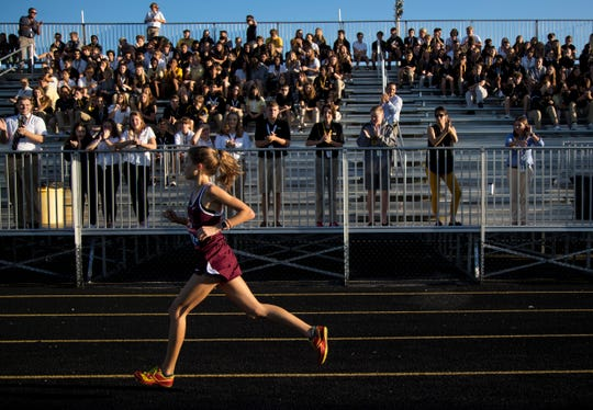 Katie Beam of First Baptist Academy leads as she enters the track at the Private 8 Cross Country Meet with a time of 19.37.38 on Tuesday, Sept. 24, 2019, at Bishop Verot High School.