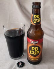 Low carbonation and ABV allow the porter creaminess and candy bar flavors to meld together in PB Cup Peanut Butter Porter from Stevens Point Brewery.