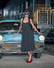 Model Twig Noir poses with a 1957 Chevrolet 150 owned by Nikie Oshefsky.
