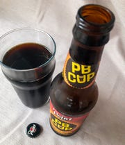 The second the cap is popped chocolate peanut butter cup aromas flood out of PB Cup Peanut Butter Porter from Stevens Point Brewery.