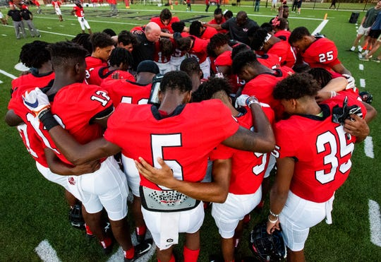 Central-Phenix City wide receiver EJ Williams (5) prays with teammates before the Prattville game at Garrett Harrison Stadium in Phenix City, Ala., on Friday September 13, 2019. Williams has committed to Clemson.