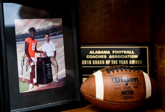 A photo of former Central-Phenix City football player Justyn Ross with his current coach, Clemson's Dabo Swinney, sits on a shelf at Central-Phenix City head coach Jamey DuBose's office in Phenix City, Ala., on Friday September 13, 2019.