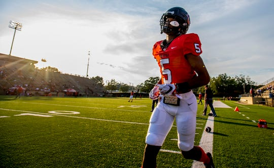Central-Phenix City wide receiver EJ Williams (5) takes the field with teammates before the Prattville game at Garrett Harrison Stadium in Phenix City, Ala., on Friday September 13, 2019. Williams has committed to Clemson.
