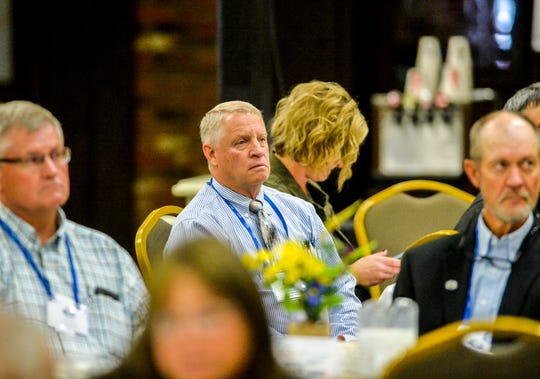 Cascade County Commissioner James Larson listens to an address by Governor Steve Bullock during the Montana Association of Counties annual conference at the Heritage Inn in Great Falls, Tuesday.
