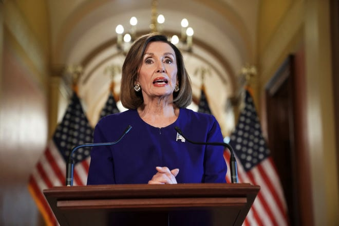 House Speaker Nancy Pelosi of Calif., reads a statement Tuesday announcing a formal impeachment inquiry into President Donald Trump.