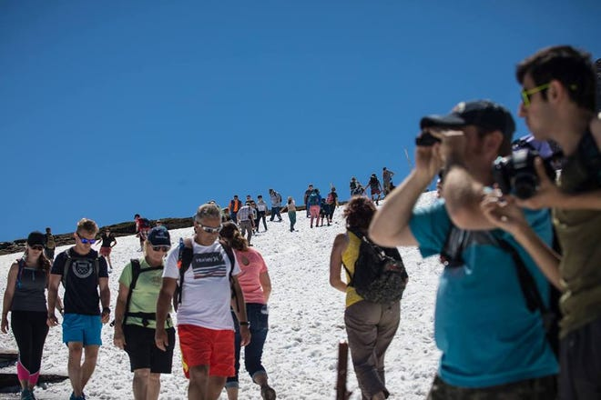 During peak season as many as 1,600 visitors a day hike Hidden Lake trail in Glacier National Park