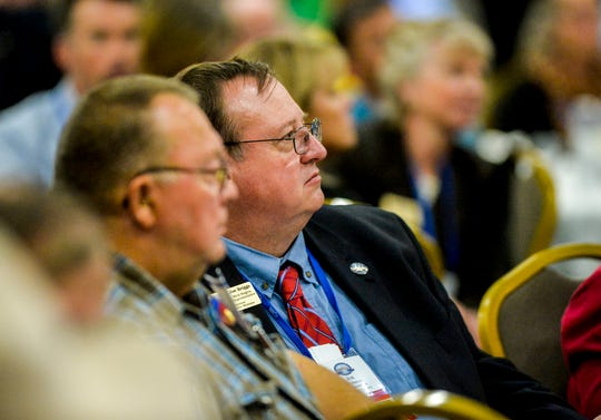 Cascade County Commissioner Joe Briggs listens to an address by Governor Steve Bullock during the Montana Association of Counties annual conference at the Heritage Inn in Great Falls, Tuesday.