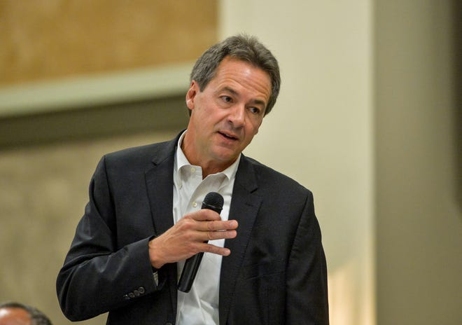 Governor Steve Bullock addresses the Montana Association of Counties conference on Tuesday afternoon at the Heritage Inn in Great Falls.