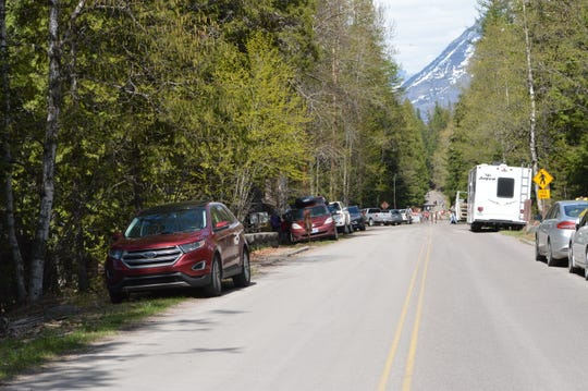 Vehicles parked on the shoulder of Going to the Sun Road present a safety hazard for both pedestrians and other motorists.