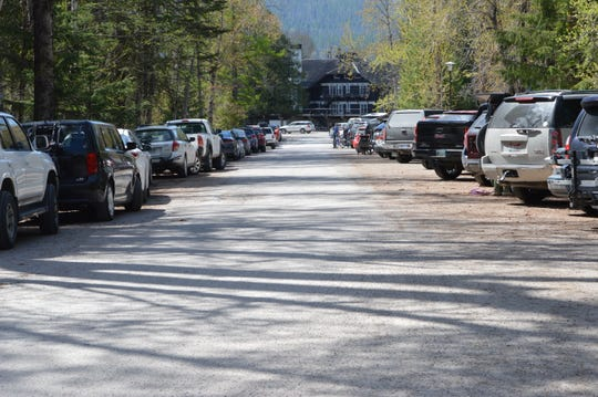 Parking lot filled beyond capacity at Lake McDonald Lodge