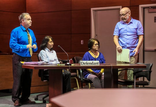 Department of Public Health and Social Services workers Jennifer Topacio, seated left, and Yolanda Digomon, seated right, appear before Superior Court of Guam Judge Maria Cenzon with their legal consels, William Pole, left, and Tom Fisher, at the Guam Judicial Center in Hagåtña on Tuesday, Sept. 24, 2019.