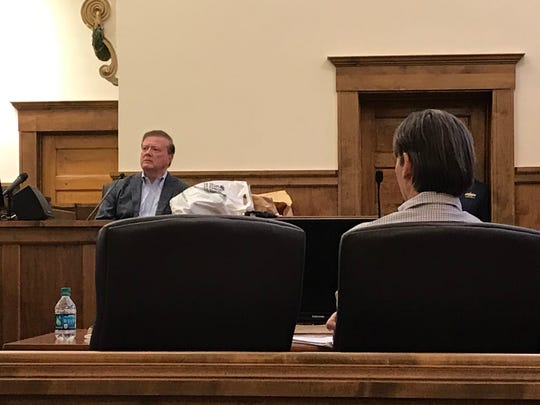 Hattiesburg businessman Tommy Duff testifies in Pearl River County Circuit Court as defendant Victor Mitchell watches Tuesday, Sept. 24, 2019.