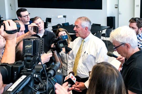Iowa athletics director Gary Barta talks with reporters, Tuesday, Sept., 24, 2019, at the Hansen Football Performance Center in Iowa City, Iowa.