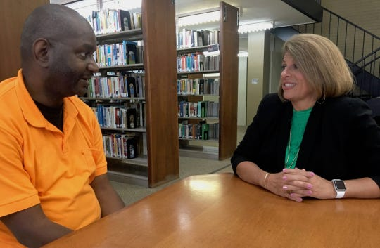 Bobby Thomas talks with his mentor, Angela Ladner, executive director of the Mississippi Psychiatric Association.