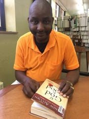 Bobby Thomas finds peace in listening to the Mississippi Mass Choir and reading books about religion.