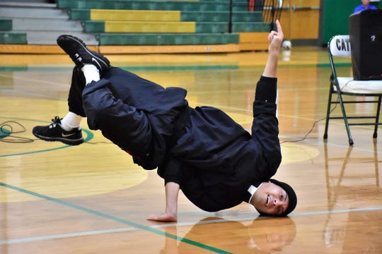 Fr. Ricardo Pineda performs a breakdance routine for students at Catholic High School during Spirit Week. Pineda is part of Fathers of Mercy, priests who perform beatbox and breakdancing while proclaiming the good news of Jesus Christ.