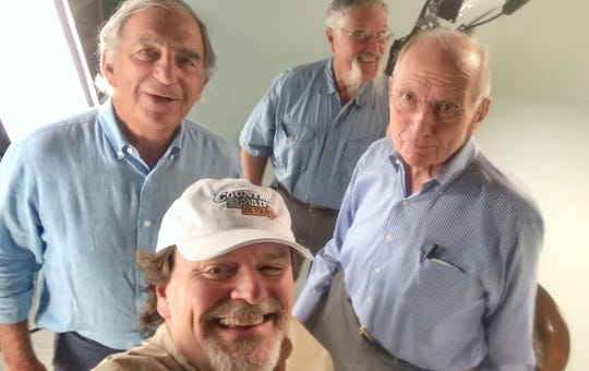 Bob Longmire (second from left) marked the occasion of his first podcast with participants Bill Landry (left), Doug Mills (back) and Jim Haslam.