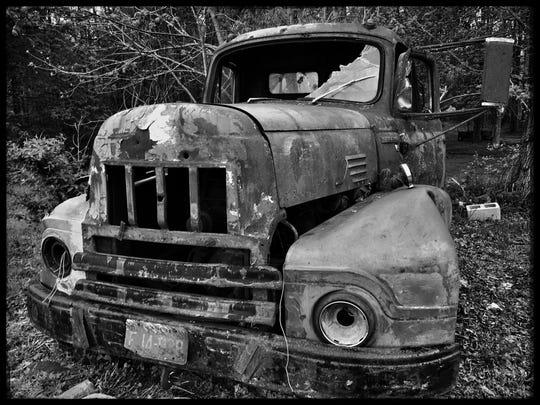 A rusty pickup truck caught Bob Longmire's eye.