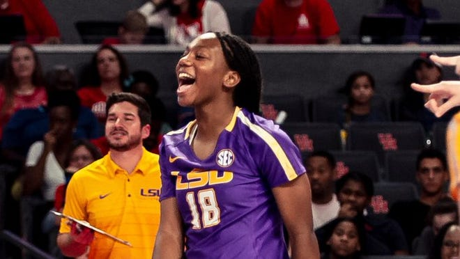 LSU volleyball player Karli Rose (No. 18), reacts during a match as assistant coach Trey Cruz looks on.