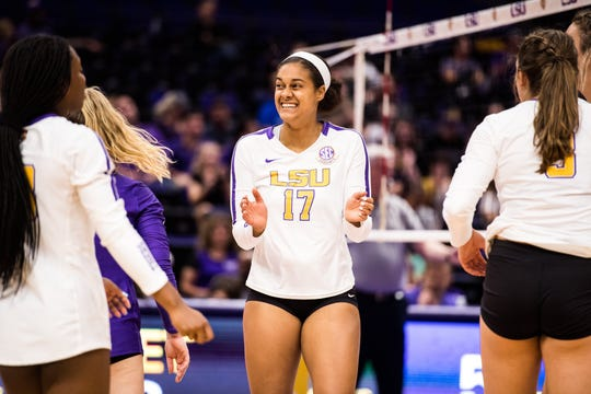 LSU volleyball player Milan Stokes (No. 17) reacts to a play.