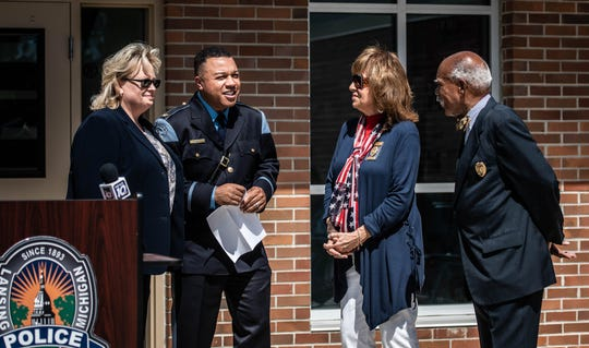 From left.  Police Commissioner Vice-Chair Sandra Kowalk-Thompson, Lansing Police Chief Daryl Green, Commissioner Patricia Farhat, and Commissioner Clyde Carnegie, pictured Thursday, Aug. 29, 2019, at the Boys and Girls Club of Lansing for Chief Green's swearing in ceremony.