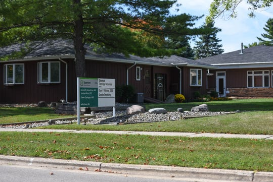A multi-unit healthcare complex at 230 Temple St. in Mason, one of two locations where physical therapist Ajay Bhargava, owner of Okemos Therapy Services, has a private practice.