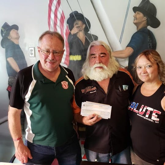 Manitowoc County Tavern League donates$250 to the Ant Hill Mob Annual Charity Riddle Run Bike Ride. Pictured, from left: Tippy Tomchek with Fuzzy Bellin and Tina Sabinaccepting the check at the regular monthly meeting of the MCTL on Aug. 5at Salute to Everyone Tavern on South 10th Street in Manitowoc.