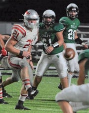 Clear Fork's Zac Clark (61) makes a block during the Colts' win over Bellevue last week. A day later, Clark saved his neighbor's life by lifting a car off his chest which had fallen off the jack stands.
