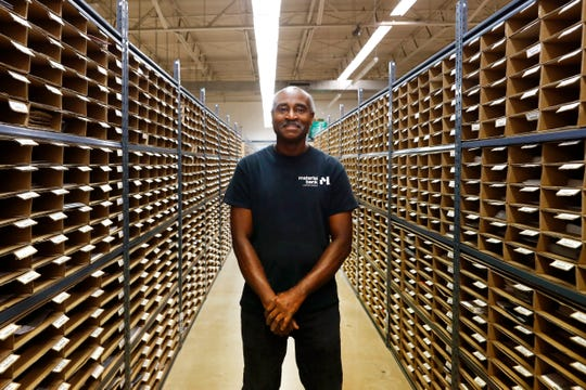 Larry Pittman, an employee at Material Bank, a shipping and storage conduit for architects and designers to preview samples for projects, stands in the Memphis facility Sept. 24, 2019. Pittman has worked for more than 40 years at the building Material Bank occupies now.