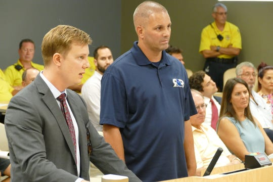 Caleb W. Pringle (left), attorney representing the Madeira condo association, speaks to the Marco Island code enforcement magistrate on Sept. 24, 2019. Dennis Kariores (right), operations manager of RR Restoration, stands next to Pringle.