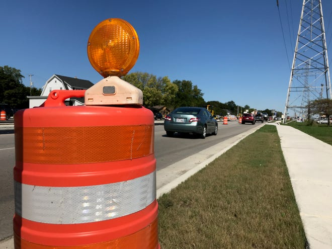 Traffic cones have lined Highway 100 for months as the Department of Transportation reconstructs a two-mile stretch. Village officials are proposing a new plan to borrow $3 million every three years to keep up with other deteriorating roads in the village.