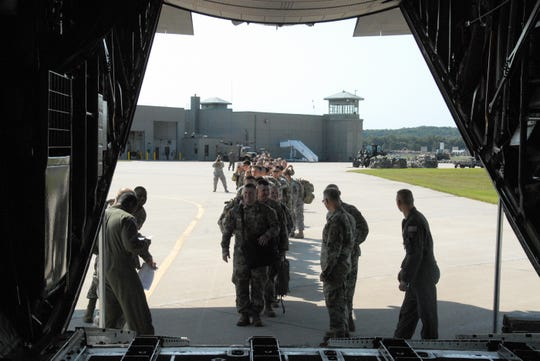 In this 2017 photo, Wisconsin Army National Guard 32nd Infantry Brigade Combat Team soldiers board a military aircraft at Volk Field to travel to Florida to assist with Hurricane Irma relief efforts. Around 160 soldiers from the 32nd are deploying to Ukraine this fall to mentor and train Ukrainian security forces.