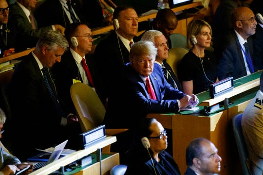 President Donald Trump listens during the United Nations Climate Action Summit during the General Assembly on Monday in New York. From left, are national security adviser Robert C. O'Brien, White House chief of staff Mick Mulvaney, Secretary of State Mike Pompeo, Trump, Vice President Mike Pence, and U.S. ambassador to the United Nations Kelly Craft.