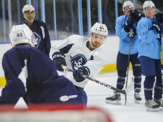 Center Tommy Novak, a River Falls native who played in three games for the Admirals last season, fires a shot on the opening day of  training camp Tuesday at the UW-Milwaukee Panther Arena.