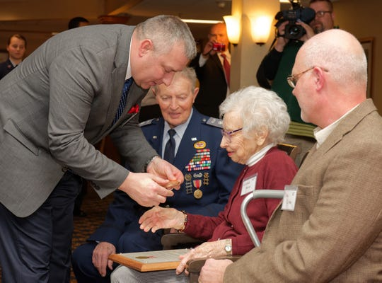 In this 2014 photo Dan Buttery, left, presents a copy of a Congressional Gold Medal to Winifred Alexy, who was a Civil Air Patrol cadet during World War II. On Tuesday, Buttery was named the new president/CEO of the War Memorial Center in Milwaukee.
