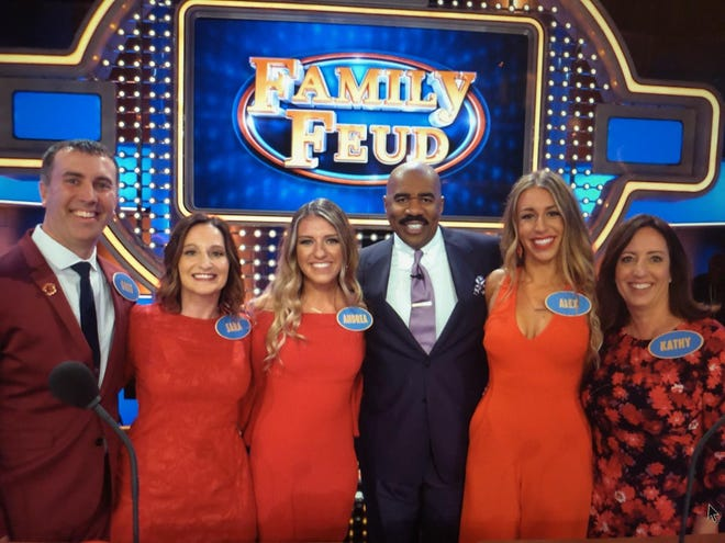 """Kathy Zubke (right) of New Berlin and members of her family will be appearing on """"Family Feud"""" at 6:30 p.m. Wednesday, Sept. 25, on CW18 Milwaukee. Pictured (from left) are Greg Beals, Sara Beals, Andrea Zubke, host Steve Harvey, Alex Zubke and Kathy Zubke."""