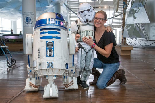 The R2 Builders Group bring their droids to Discovery World's Sci-Fi Family Day to interact with visitors.