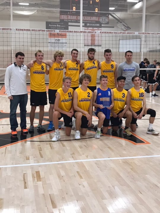 Members of the Catholic Memorial boys volleyball team pose with the championship trophy after winning the Dave Hash Memorial Tournament Saturday at Kaukauna.