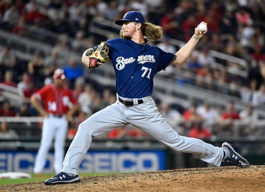 Milwaukee Brewers relief pitcher Josh Hader (71) throws against the Washington Nationals during the ninth inning at Nationals Park.