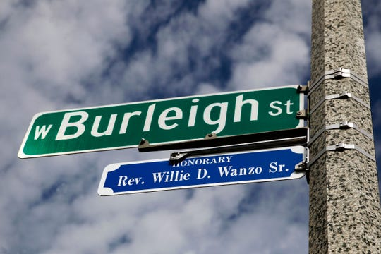 A sign honoring the late Rev. Willie D. Wanzo Sr. is seen at North 13th and West Burleigh streets, in honor of Wanzo's legacy at Metropolitan Missionary Baptist Church, at the corner of Burleigh and 14th streets.