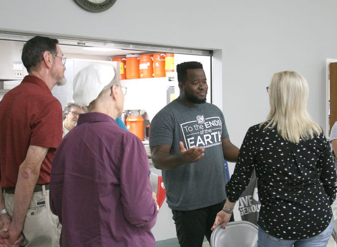 Yves Dushime (center) visited with representatives from a number of churches in the Twin Lakes Area who came to hear about his first-hand experience as a recipient of the Operation Christmas Child shoebox program.