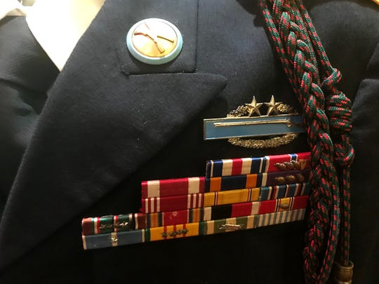 Medals on the vest of Pete Vowell's Class A Uniform tell the story of his 32-year military career.