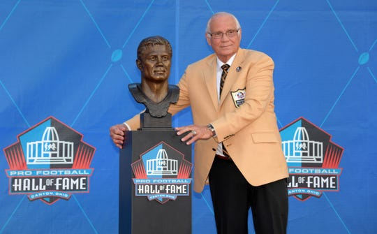Johnny Robinson poses with bust during the Pro Football Hall of Fame Enshrinement at Tom Benson Hall of Fame Stadium. Benson was inducted into the hall in August.