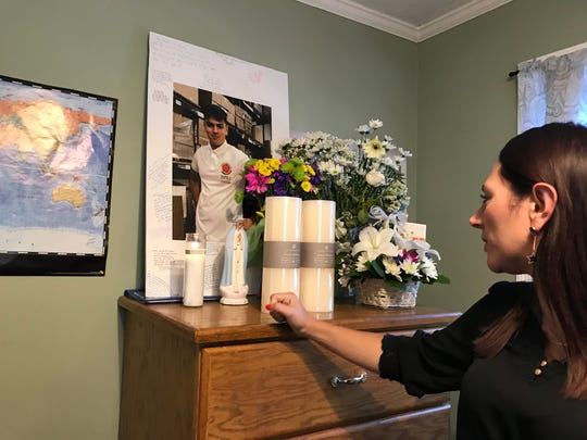 Steven's Aunt, Yirlay Gomez, looks at a photo of Steven in his room.