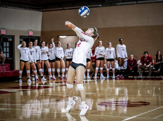 Alabama volleyball defensive specialist PG Garrison passes the ball during a match.