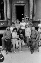 Former President Jimmy Carter, center, poses for a photo in front of a burnt-out Manhattan apartment building in 1984. Carter happened upon the Habitat for Humanity project while on a jog and volunteered to join the effort. The Carter Work Project was devised and is now heading into its 36th year with a project in Nashville.