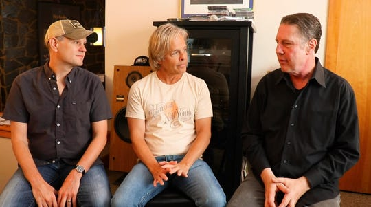 Troy Verges, left, and Marv Green talk to Bart Herbison of Nashville Songwriters Association International.